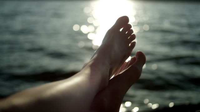 relaxing above the lake. sunset - sunbathing stock videos and b-roll footage