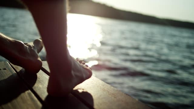 stockvideo's en b-roll-footage met ontspannend boven het meer. zonsondergang - een bad nemen
