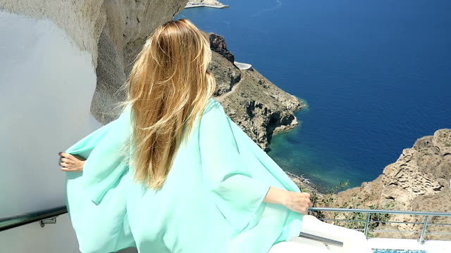 relaxing above the sea & flying tunic - santorini stock videos and b-roll footage
