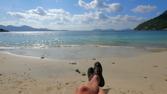 relaxing at the beach - legs crossed at ankle stock videos and b-roll footage