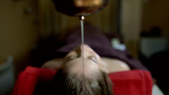 relaxing ayurveda - massage table stock videos & royalty-free footage