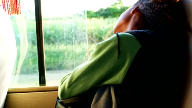 relaxing by the open window in a bus - afro caribbean ethnicity stock videos and b-roll footage