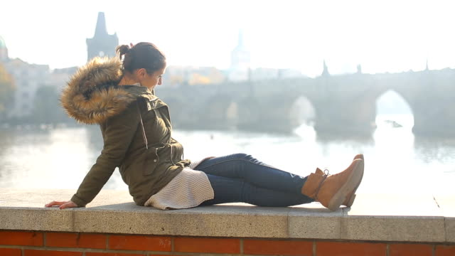relaxing by the river - charles bridge stock videos and b-roll footage