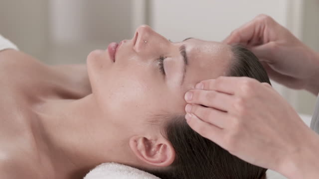 hd dolly: relaxing facial massage - facial massage stock videos and b-roll footage