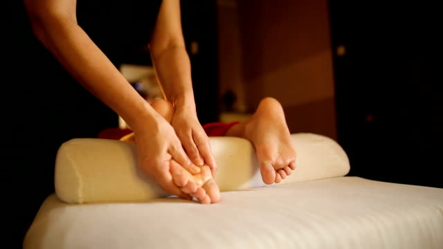 relaxing foot massage - massage stock videos & royalty-free footage