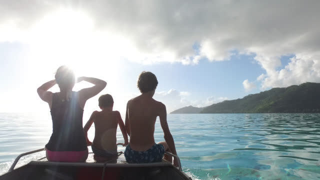 relaxing in boat on water - huahine island stock videos & royalty-free footage