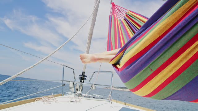 SLO MO Relaxing in hammock on a boat