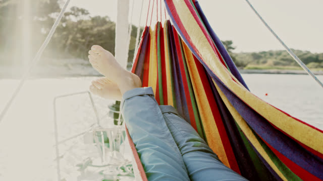 ws relaxing in hammock on a sailboat deck - hammock stock videos & royalty-free footage