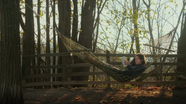 relaxing in nature. tourism in serbia - hammock stock videos & royalty-free footage