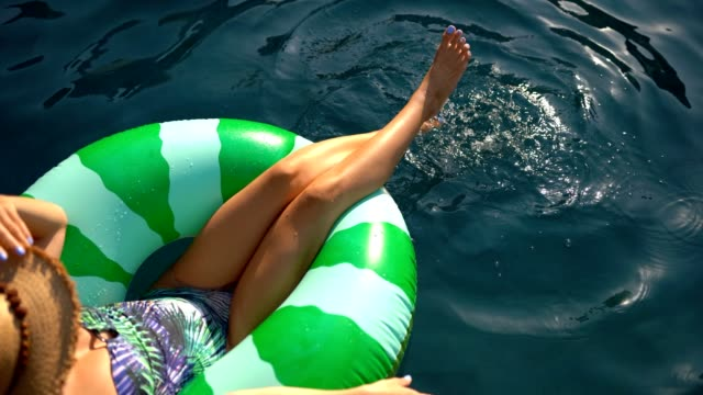 relaxing in the pool - floating on water stock videos & royalty-free footage