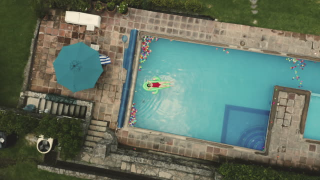 relaxing in the pool - patio stock videos & royalty-free footage
