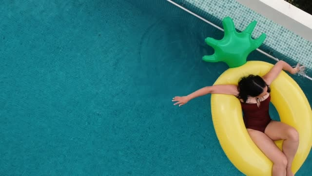relaxing in the pool - rubber ring stock videos & royalty-free footage