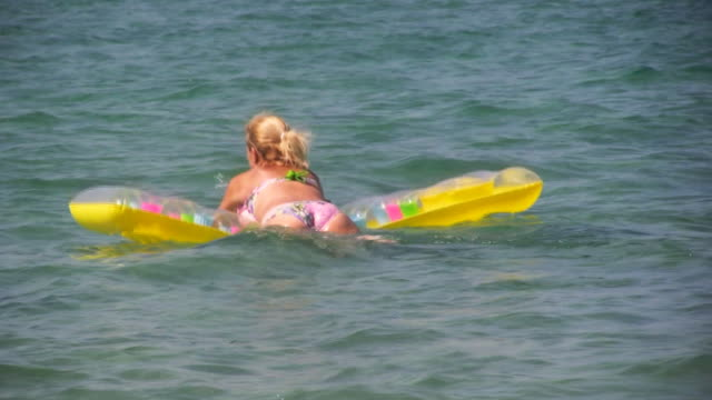 hd: relaxing in the water - inflatable stock videos & royalty-free footage
