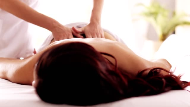 relaxing massage treatment at spa - massage table video stock e b–roll