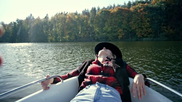 relaxing on a kayak. sunny autumn day - reclining stock videos & royalty-free footage