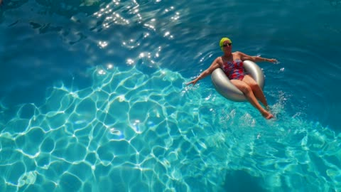 relaxing on holiday - floating on water stock videos & royalty-free footage