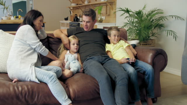 relaxing on sofa - 45 49 anni video stock e b–roll