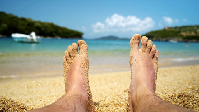 relaxing on the beach - reclining stock videos & royalty-free footage
