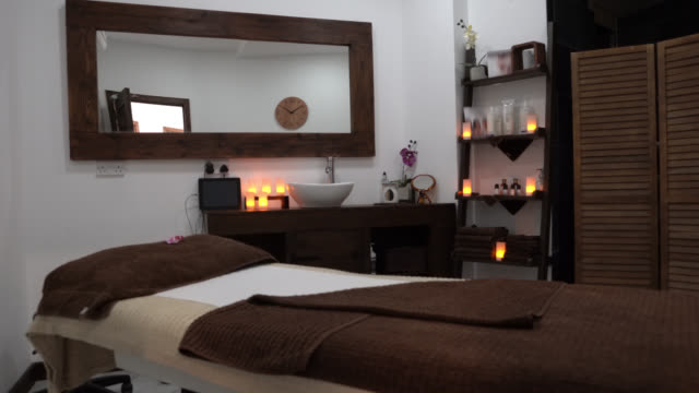relaxing space to get pampered on a stressful day - spa treatment stock videos & royalty-free footage
