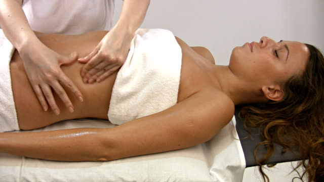 relaxing stomach massage - health spa stock videos and b-roll footage