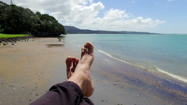 relaxing - legs crossed at ankle stock videos and b-roll footage
