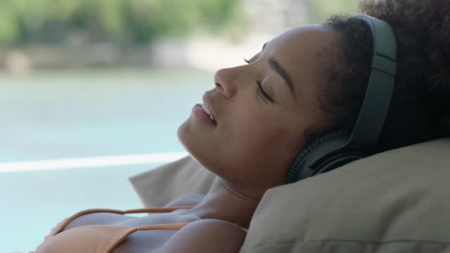 relaxing - listening stock videos & royalty-free footage