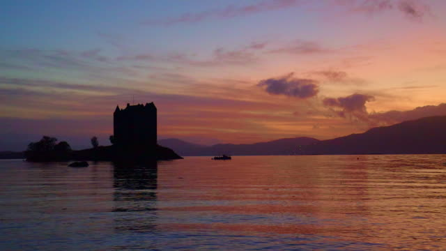 relaxing view of the stalker castle on island during sunset with burning sky in the scottish highlands. - romantic sky stock videos & royalty-free footage