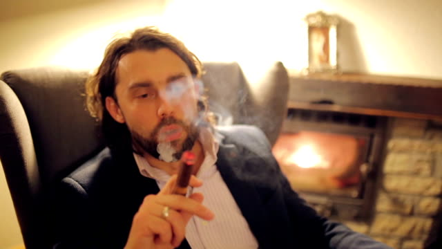 relaxing with a cigar - sigaro video stock e b–roll
