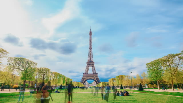 relaxing with eiffel tower in sunny summer day - eiffel tower stock videos and b-roll footage