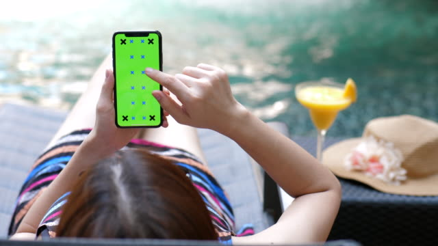 relaxing with phone,chroma key - standing water stock videos & royalty-free footage