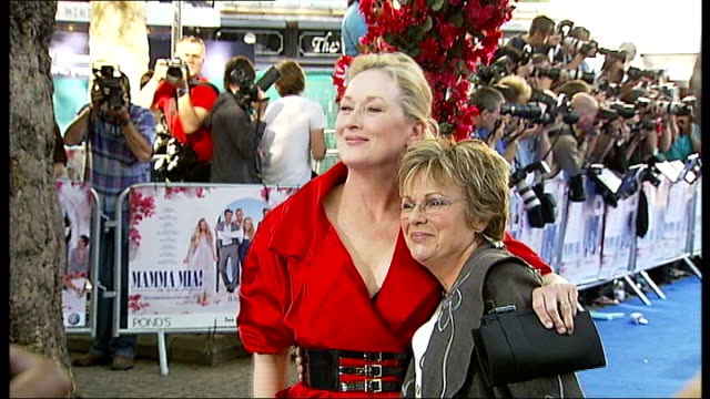 release of new abba musical 'mamma mia the movie' england london photography * * benny andersson posing next his wife on red carpet at london... - pierce brosnan stock videos and b-roll footage