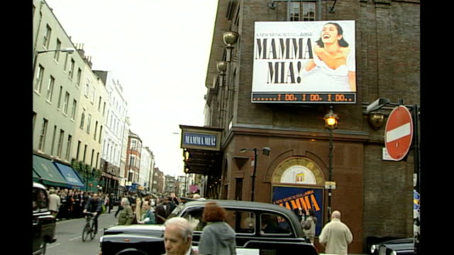 release of new abba musical 'mamma mia the movie' tx 641999 theatre advertising west end musical 'mamma mia' tx 741999 int cutaways audience watching... - mamma mia stock videos and b-roll footage
