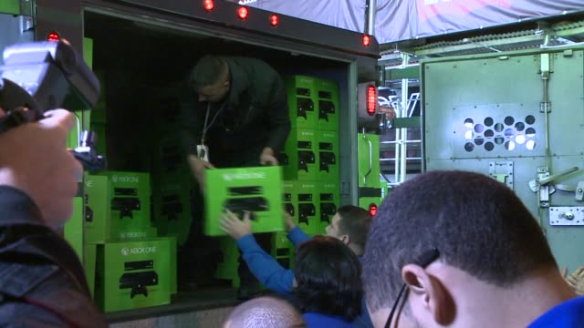 release of the xbox one at the best buy in time square unloading xbox one machine on november 21 2013 in new york new york - xbox stock videos & royalty-free footage