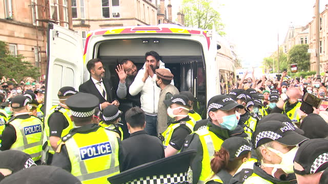 release of two indian nationals who were detained in a home office immigration van by immigration officers, a mass protest in glasgow helped their... - politics concept stock videos & royalty-free footage