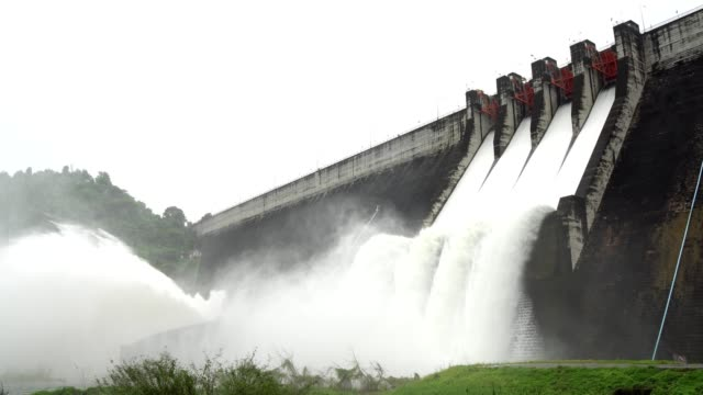 release of water at a dam wall. - alternative energy stock videos and b-roll footage