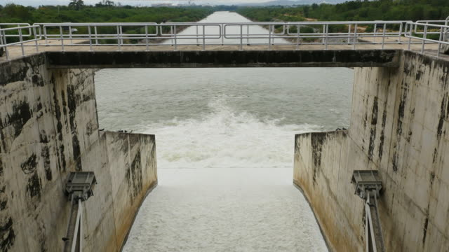 releasing water flow from the dam. - dam stock videos and b-roll footage