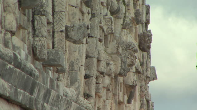 cu relief carvings on west building of nunnery quadrangle at pre-columbian ruined city of maya civilization / uxmal, yucatan, mexico - pre columbian stock videos & royalty-free footage