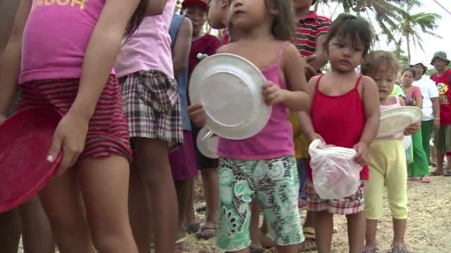 Relief goods from private donors and neighbouring communities spared by the typhoon are being distributed to remote villages in Eastern Samar...