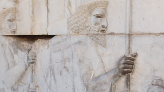 relief in persepolis, capital city of first persian empire - persepoli video stock e b–roll