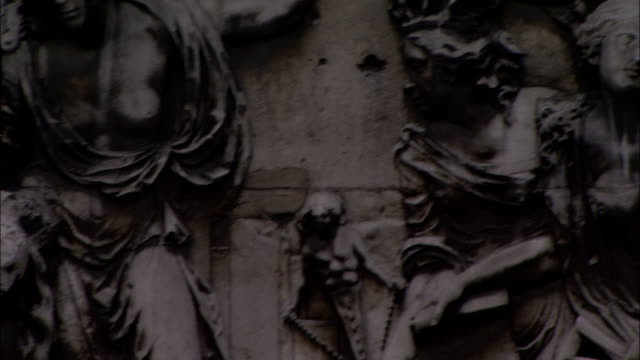 reliefs decorate the base of the monument to the great fire of london. - carving craft product stock videos & royalty-free footage