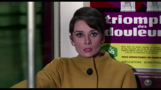 1963 relieved woman (audrey hepburn) watches frustrated man (cary grant) through locked train car door - audrey hepburn stock videos & royalty-free footage