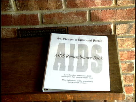 religious art and aid remembrance book in miami florida - hiv stock videos & royalty-free footage