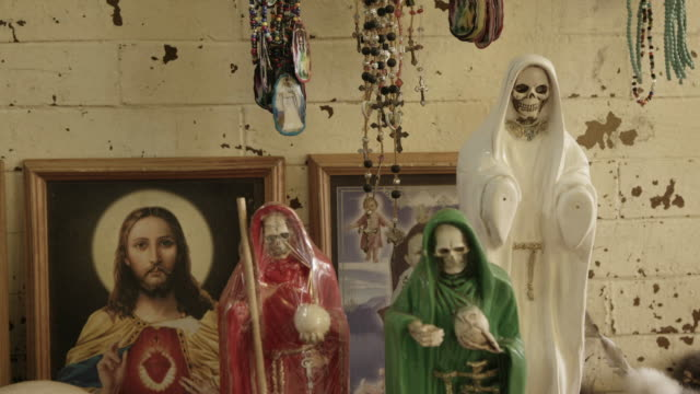 religious artwork and santa muerte statues in mexico - afterlife stock videos and b-roll footage