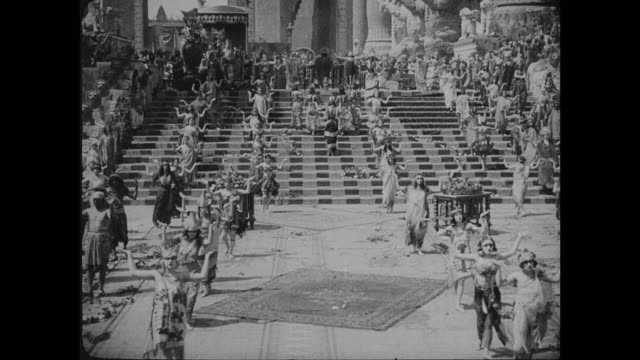 a religious ceremony takes place in the grand city of babylon - silent film stock videos & royalty-free footage
