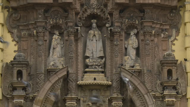 religious effigy carvings on building - effigy stock videos & royalty-free footage