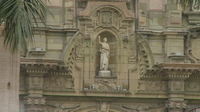 religious effigy statue on building - effigy stock videos & royalty-free footage