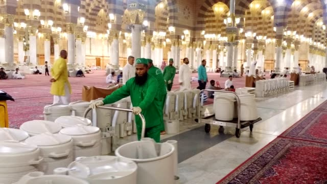 religious employees replacing empty water (zam zam) coolers in prophet's mosque - water cooler stock videos & royalty-free footage