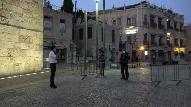 religious jew argues with israeli policeman after denied passage at a checkpoint in jaffa gate as israel enters a new coronavirus lock-down on... - jaffa stock videos & royalty-free footage