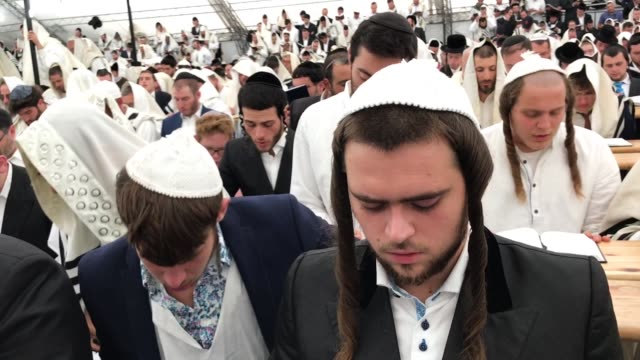 religious jews pray and celebrate in a tent synagogue on the first day of rosh hashanah on september 10 2018 in uman ukraine tens of thousands of... - judaism stock videos & royalty-free footage
