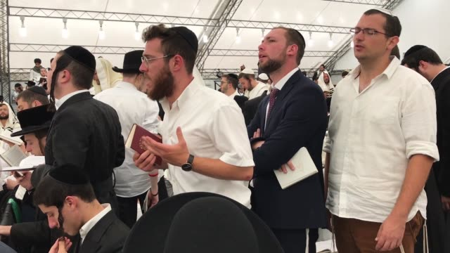 religious jews pray and celebrate in a tent synagogue on the first day of rosh hashanah on september 10, 2018 in uman, ukraine. tens of thousands of... - rosh hashanah stock videos & royalty-free footage